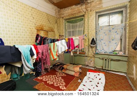 Sleeping area for refugee and refugees' clothes is drying of on the rope in the temporary apartment