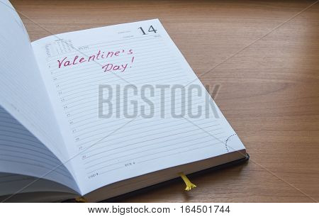The inscription in the open diary Valentine's Day.