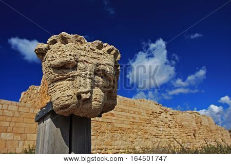 An ancient sculpture of a lion's head is displayed on the site of Caesarea, Israel.