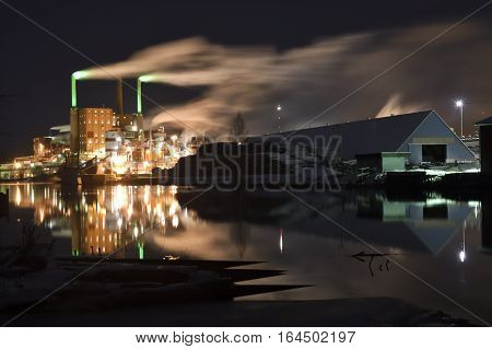 Pulp factory in the night with lot of smoke Picture from the North of Sweden.