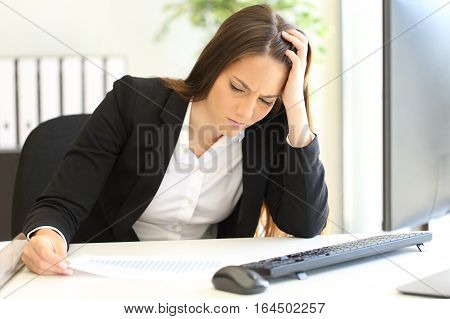 Depressed and ruined businesswoman looking at negative growing graphic after bankruptcy poster