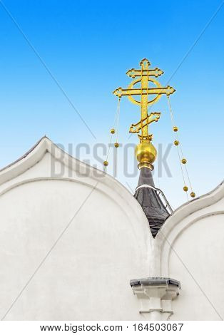 Orthodox golden cross on a dome of church in Kaunas. Lithuania.