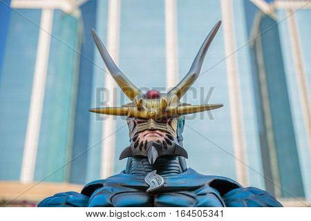 Hong Kong, China - December 5, 2016: Lord Dragon zoom edition, statue of famous characters, in Hong Kong Avenue of Comic Stars, Kowloon Park. Defocused background of Tsim Sha Tsui District.