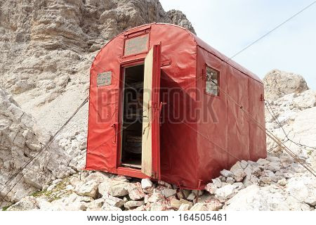 Red Bivouac shelter hut Bivacco De Toni in Sexten Dolomites mountains in South Tyrol Italy