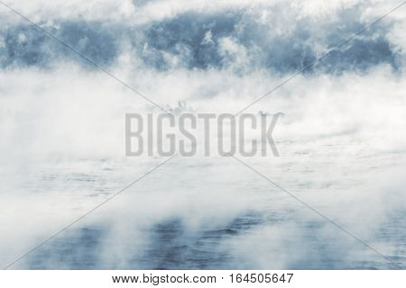 Island far in distance in a vaporing sea