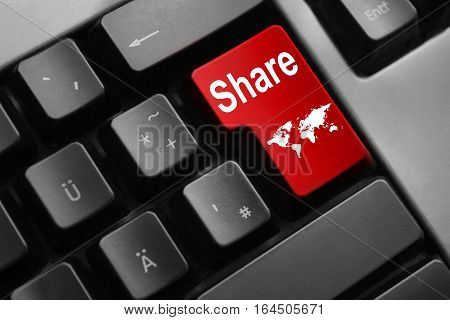 grey keyboard with red enter key share internet