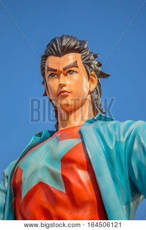 Hong Kong, China - December 5, 2016: close up of Wang Xiao Hu, statue of famous characters, in Hong Kong Avenue of Comic Stars, Kowloon Park. Blue sky background.