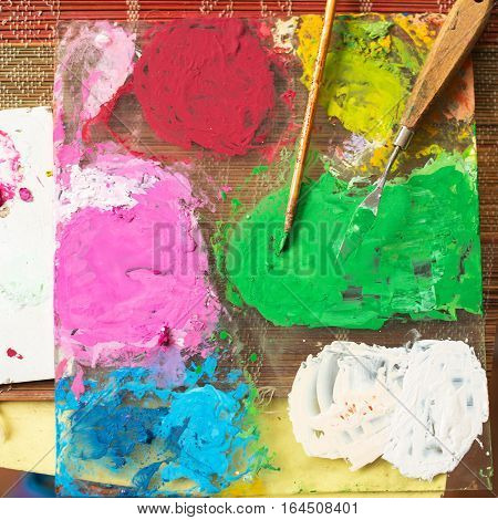 Colorful Palette Of The Artist With A Greenery Spot In The Center