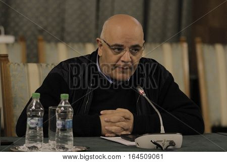 Bucharest Romania 11 November 2015: Raed Arafat Secretary of State- Head of the Department of Emergency Situations at Ministry of Internal Affairs speaks at a press conference hold at Government Headquarters on Colectiv blaze subject.