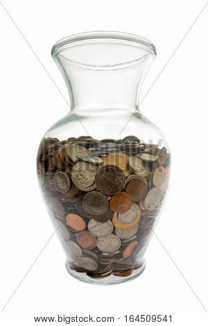 Wide angle view of United States Coins collected in a generic looking glass vase