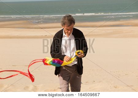 A Grandfather Brings Back The Kite From His Granddaughter Or Grandson