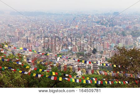 Kathmandu city Nepal. View of Kathmandu city with prayer flags from Swayambhu or Swayambhunath stupa.