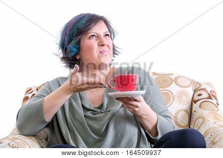 Grimacing Woman Gesturing To Cup Of Coffee