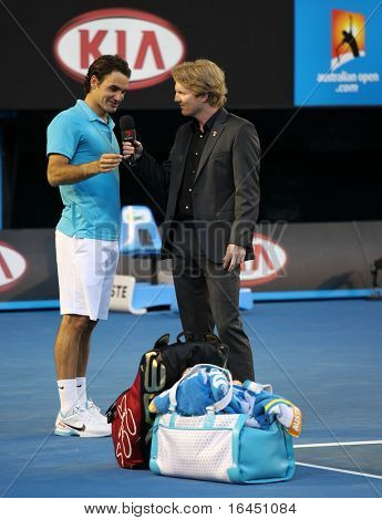 MELBOURNE - JANUARY 27: Roger Federer gives an interview to Jim Courier after his quarter final win over Nikolay Davydenko in the 2010 Australian Open on January 27, 2010 in Melbourne