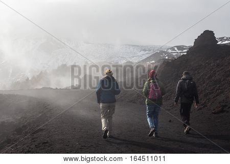 people walking through a landscape at the volcano Etna Sicily - Italy