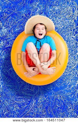 Happy Young Boy Relaxing In A Summer Pool