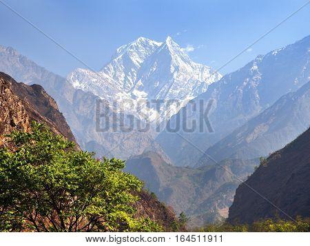 Mount Nilgiri and Kali Gandaki Nadi canyon round Annapurna circuit trekking trail mountain landscape annapurna region Nepal