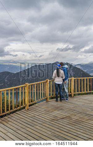 LATACUNGA, ECUADOR, FEBRAURY- 2016 - Young couple at viewpoint in Quilotoa lake Latacunga Ecuador