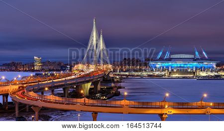 Saint-Petersburg Russia - December 28 2016: Winter cityscape to the football stadium to the World Cup in 2018 cable-stayed bridge and highway at night.