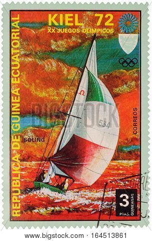 MOSCOW RUSSIA - January 09 2017: A stamp printed in Equatorial Guinea shows yachting the race in Soling class series