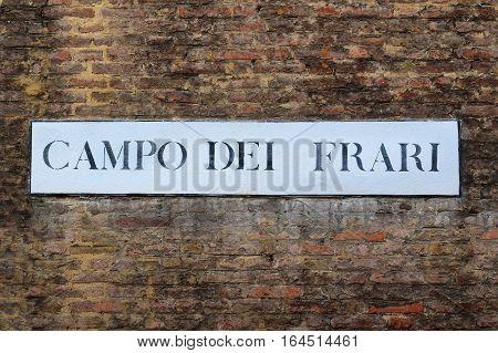Campo dei Frari, street plate on a brick walls of basilica Santa Maria Gloriosa dei Frari in Venice, Italy poster