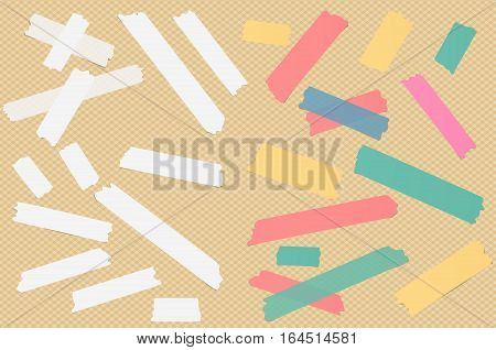 Colorful different size sticky paper, adhesive, masking tape are on squared background.