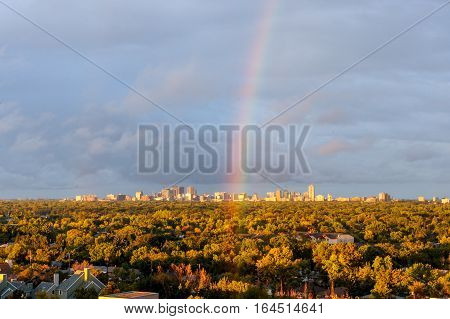 Aerial view at the Winnipeg city during rainbow after rain.