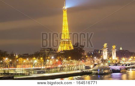 Paris; France-January 08 2017 : The Eiffel tower is a wrought lattice tower on the bank of Seine river in Paris.The tower is the tallest structure in Paris and the most visited monument in the world.