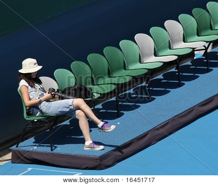 MELBOURNE, AUSTRALIA - MARCH 7: Photographer at the Australia vs Chinese Taipei Davis Cup tie on March 7, 2010 in Melbourne, Australia