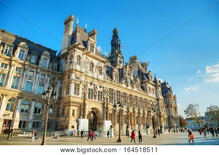 PARIS - NOVEMBER 2: City Hall building (Hotel de Ville) with tourists on November 2 2016 in Paris France.