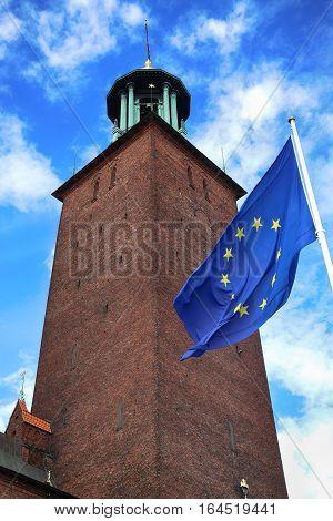 Stockholm City Hall ( Stockholms stadshus) with EU flag in Stockholm Sweden