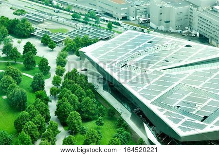 Aerial view of BMW World BMW Museum and BMW Tower from The Olympic Tower in Munich Germany