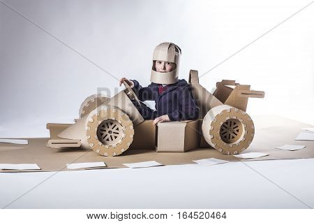 photo of young racer on a cardboard racin