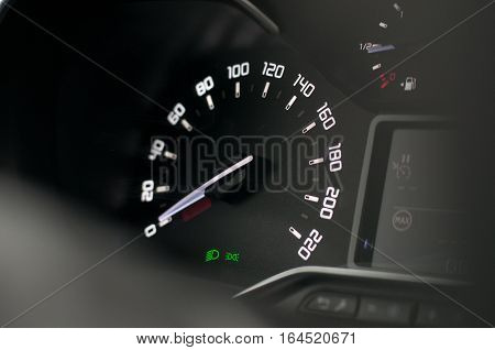 Speedometer in the new car. Modern and black background.