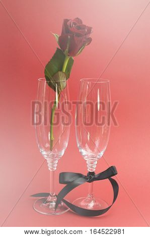 Red Rose In Champagne Glasses