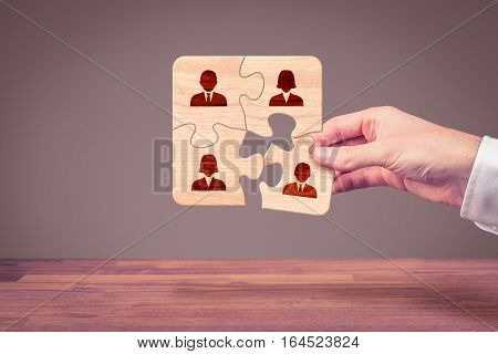Assemble a team concept. Business team, human resources, cooperation, connection and unity concepts. Good team fit together like a puzzle pieces.