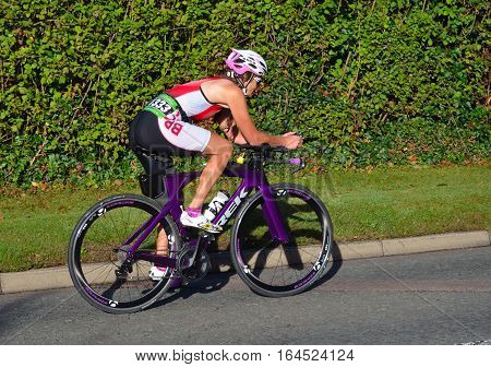 ST NEOTS, CAMBRIDGESHIRE, ENGLAND - SEPTEMBER 11, 2016: Triathlon competitor on road cycling stage of competition.