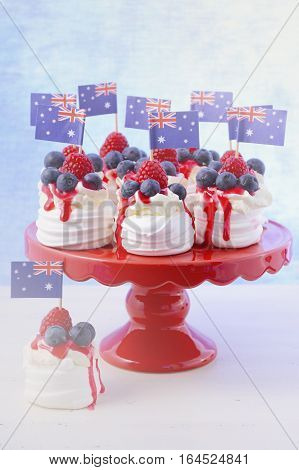 Australian mini pavlovas and flags in red white and blue for Australia Day or national holiday party food treats with applied faded retro style filters.