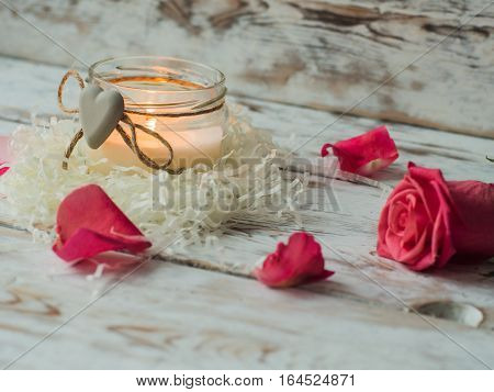 Burning candle on rustic wooden table. Valentine's Day and Mother's Day background