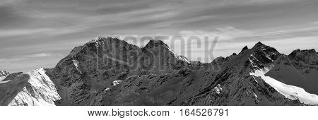 Black And White Panorama On Winter Snow Mountains