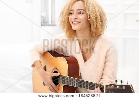 The joy that comes from musicAcoustic guitar. Relax while playing the guitar. Girl playing the guitar.