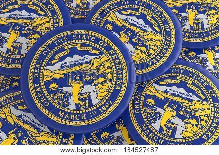 US State Buttons: Pile of Nebraska Flag Badges 3d illustration