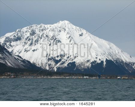 Beautiful shot of a snow covered mountain peak taken from Resurrection Bay on the Kenai Pennisula. poster