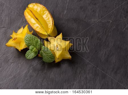 Cutted starfruit or carambola healthy dessert with mint leaf