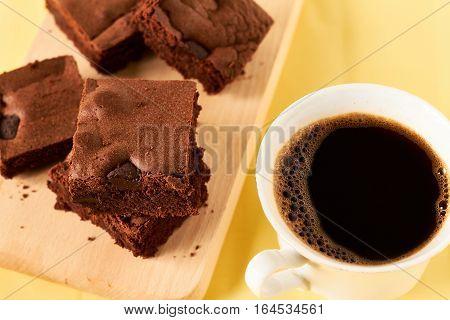 Homemade chocolate brownies with coffee, close up