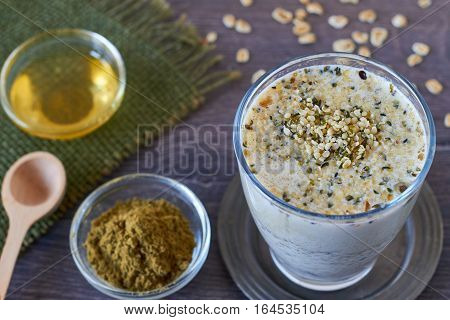 Homemade smoothie made from oats milk, shelled hemp and honey