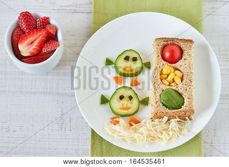 Healthy and fun snack for kids, funny traffic light sandwich and bird faces