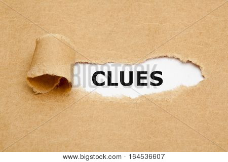 The word Clues appearing behind ripped brown paper.
