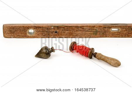 Old level tool and plummet isolated on white background