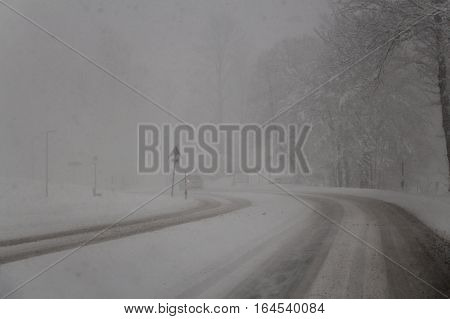 The view of snow-covered road in blizzard. Snowstorm. Winter time.